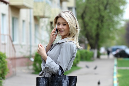portrait of young woman talking on mobile phone  photo