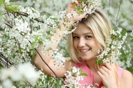 Portrait of beautiful blond in spring blossom  photo
