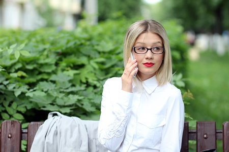 portrait of young woman talking on mobile phone Stock Photo - 14284222