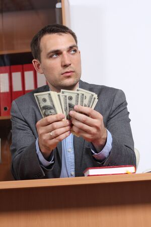A young man with dollars in their hands photo