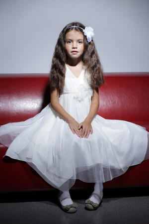 little girl sitting: fashion beautiful little girl