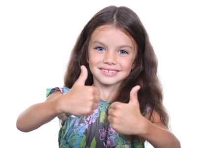 Beautiful little girl shows finger as sign that everything is fine photo