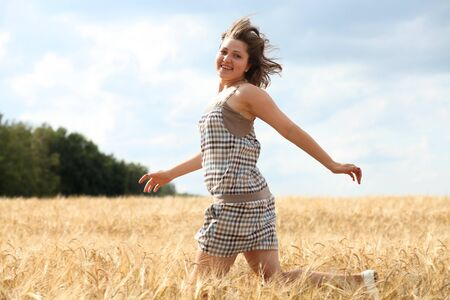 Happy woman in golden wheat  photo
