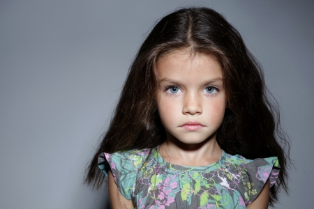 close up portrait of young beautiful little girl with dark hair photo