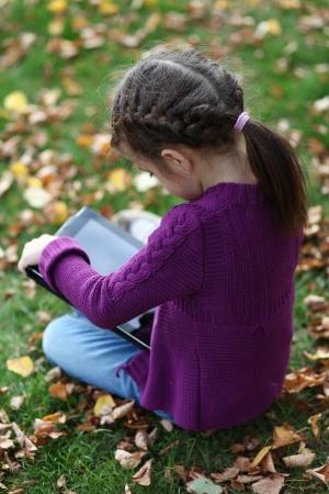 Little Girl holding tablet digital computer Stock Photo - 15464492