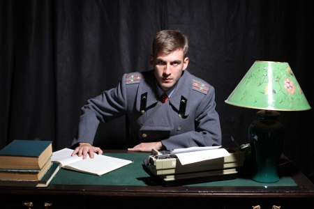 colonel: Russian military officer in a dark cabinet Stock Photo