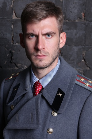 sergeant: portrait of Russian military officer in greatcoat