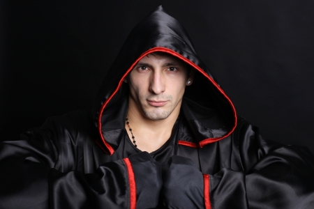 hooded: Young man in a monks robe