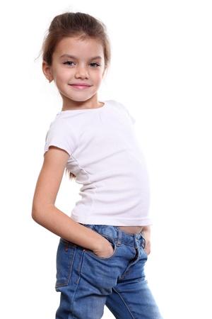 portrait of pretty little girl in blue jean Stock Photo