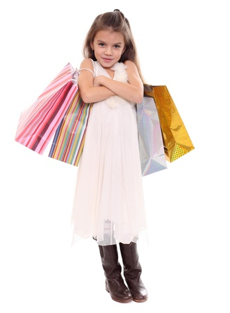 Beautiful little girl with shopping bags  photo