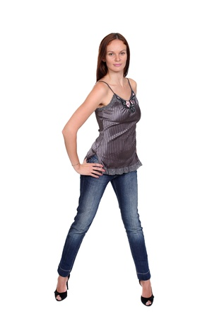 Full length of a beautiful young lady in blue jeans photo