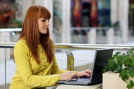 Young pretty business woman with notebook in the office Stock Photo - 16595949