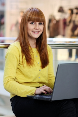 Young pretty business woman with notebook in the office  Stock Photo - 16620889