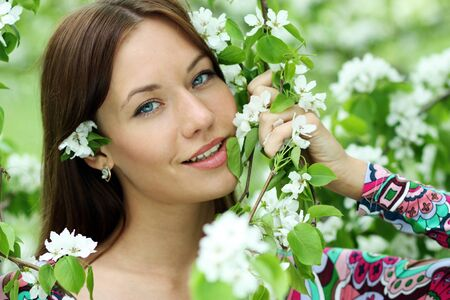 Portrait of beautiful woman in spring blossom  Stock Photo - 16620856
