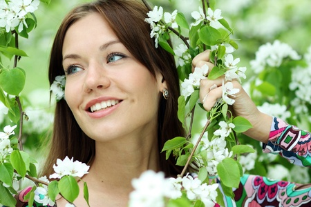 Portrait of beautiful woman in spring blossom  Stock Photo - 16620890