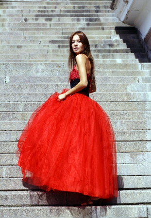 Young woman in a red gothic dress  photo