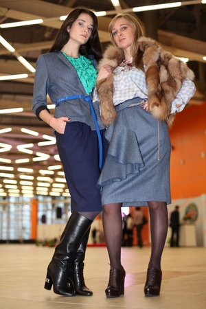 designer clothes: portrait of two women in stylish designer clothes