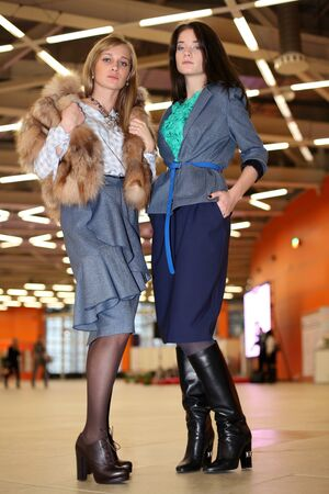 portrait of two women in stylish designer clothes photo