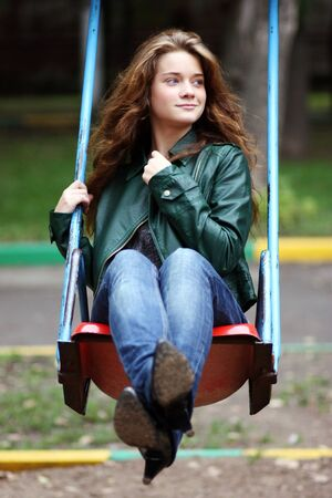 woman swinging on a swing photo