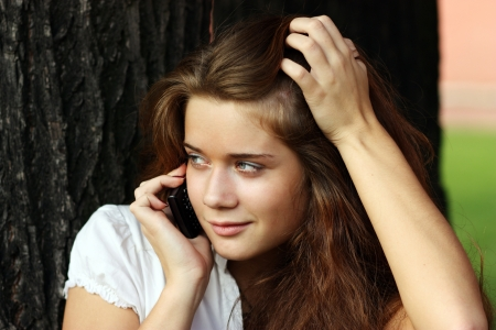 Young woman calling by phone Stock Photo - 16595946