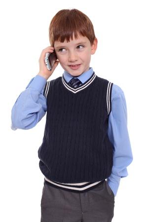 niÑos hablando: El niño pequeño llamando por teléfono