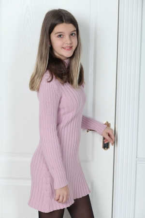 russian girls: Little girl standing at the white door closed Stock Photo