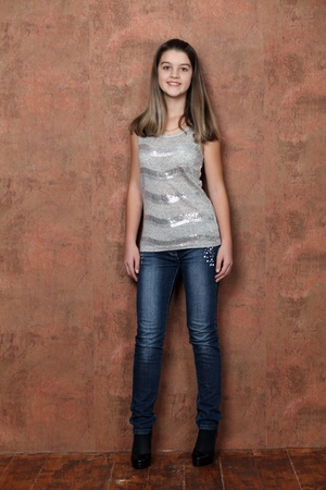 Full length of a beautiful little girl in blue jeans photo