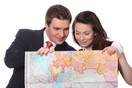stodio: Closeup of a happy casual couple with map isolated on the white