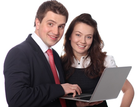 stodio: Closeup of a happy casual couple looking at laptop