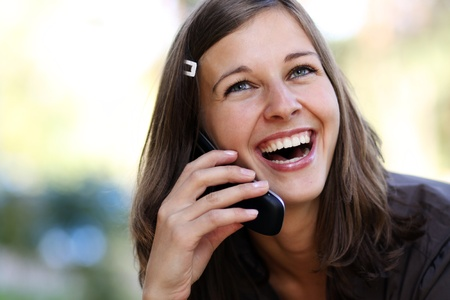 Young woman calling by phone Stock Photo - 17320519