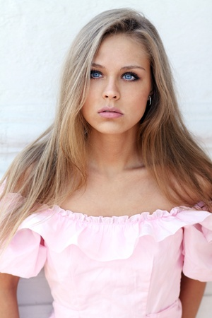 Beautiful young girl in pink dress photo