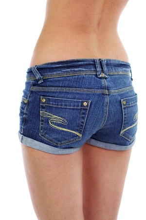 Beautiful young girl in blue jeans photo