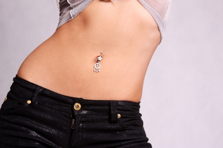 piercing in the navel Stock Photo
