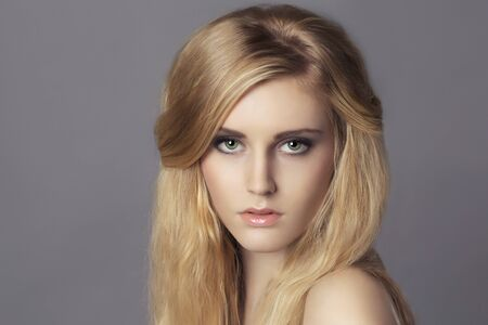 Portrait of young beautiful blond woman photo