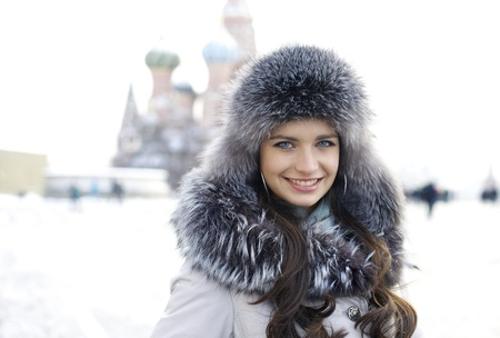 Portrait of a young woman on the background of a winter city Stok Fotoğraf