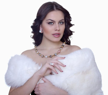 Portrait of attractive brunette in a fur coat photo