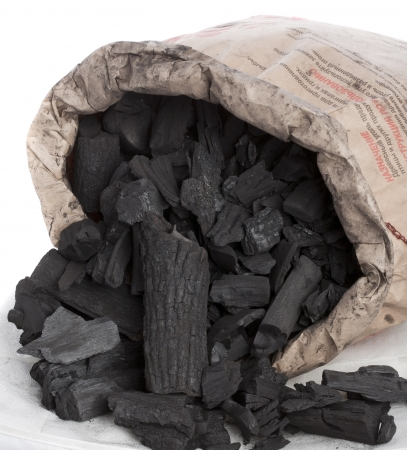 charcoal in a paper bag Stock Photo