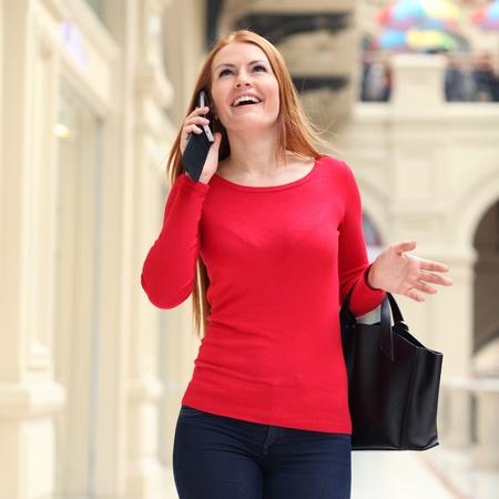 Beautiful young woman walking in the shop Stock Photo - 18766265