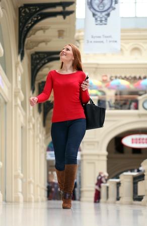 Beautiful young woman walking in the shop Stock Photo - 18762901