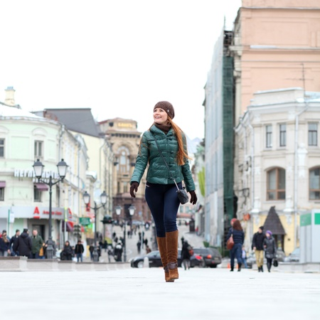Full length, Walking woman in autumn Moscow street photo