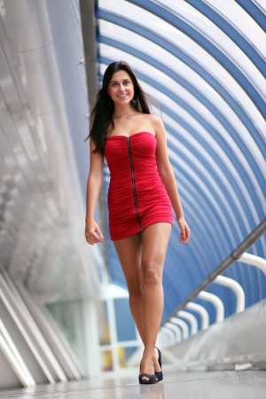 Beautiful walking woman in red dress photo