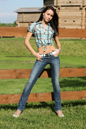 waist belt: Young woman in blue jeans and cell shirt