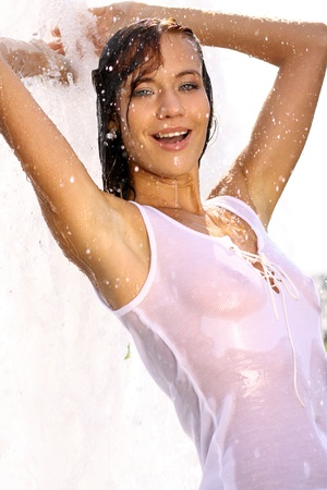 Young sexy woman bathes in a city fountain  photo