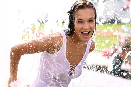 Young sexy woman bathes in a city fountain  Stock Photo