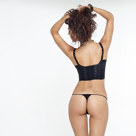 back of woman: Modelo de ropa interior atractiva aislada en blanco