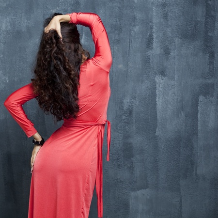 Portrait of back woman in red sexy dress  photo