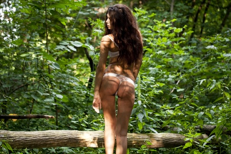 underclothes: Charming woman sexy serious background dark forest  Stock Photo