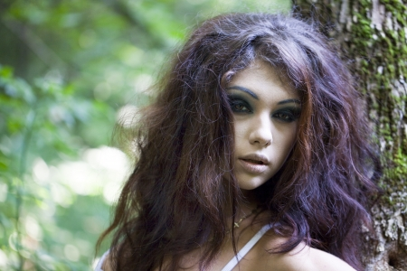 Mysterious young woman with make up photo