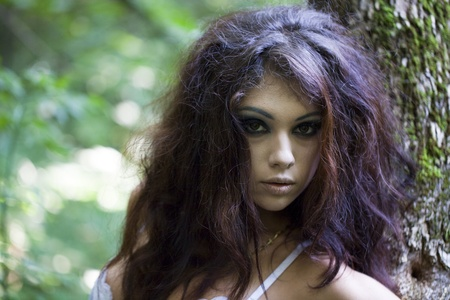 Mysterious young woman with make up