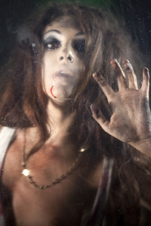 Bloody and scary looking  woman photo